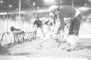 Photo of laborers pouring concrete.