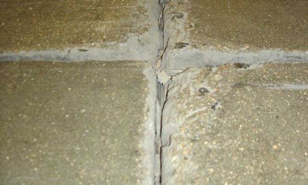 Photo of concrete joint filler close up in bad quality joint.