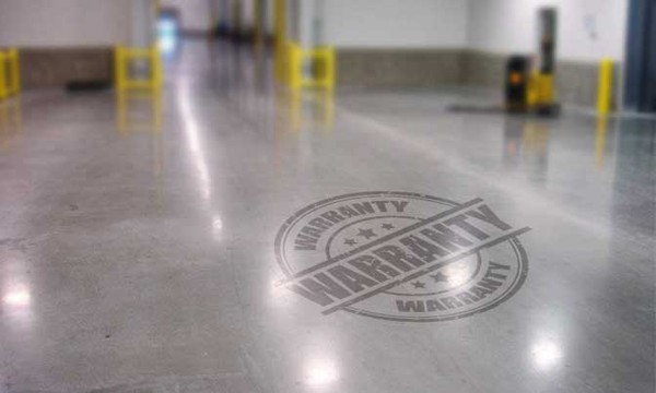 Photo of Warranty icon on highly polished floor surface.