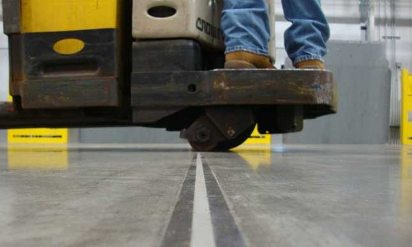 Close-up photo of armored joint on highly durable Fricks floor.